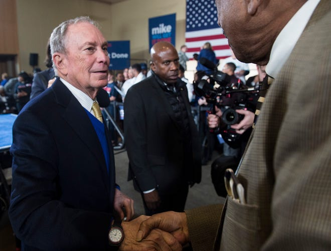 Presidential candidate Mike Bloomberg shakes hands with supporters during a rally at Alabama State University student center in Montgomery, Ala., on Saturday, Feb. 8, 2020.