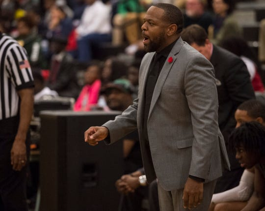 Lanier coach Brian Williams talks with his team from the bench during the Class 6A, Area 4 championship at Carver High School in Montgomery, Ala., on Friday, Feb. 7, 2020.