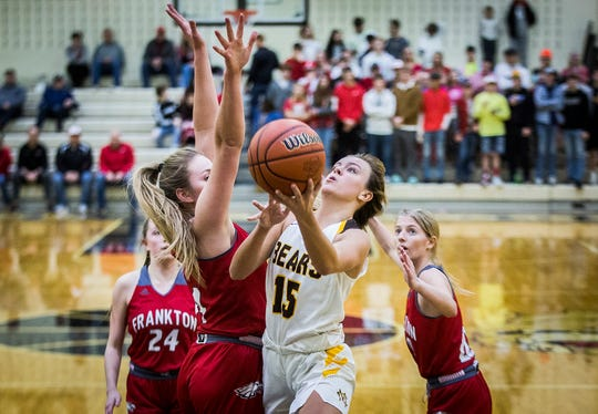 Monroe Central's Hannah Bolton shoots past Frankton's defense during their game at Lapel High School Friday, Feb. 7, 2020.