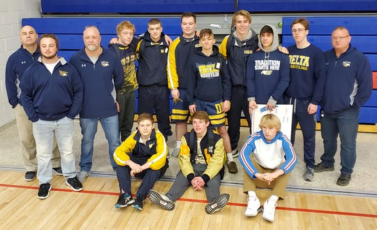 Members of Delta's wrestling team pose for a photo following their second-place finish at the Jay County regional on Feb. 8, 2020.