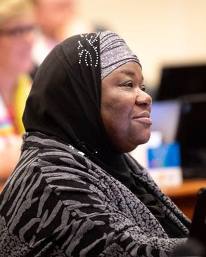 Metro Council member Zulfat Suara listens during a council meeting Feb. 4, 2020.