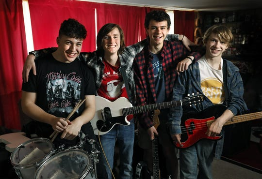 From left, Jaxson Tackett, 16, of Marion, Henry Byrne, 17, of Hilliard, Jack Lutz, 17, of Heath, and Alex Brannon, 18, of Newark, form the band Aura. The band will be competing in the Rock and Roll Hall of Fame in Cleveland as part of a battle of the bands competition. They were rehearsing at Jack's home Feb. 2, 2020.
