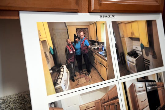 Photos of Shelly Pearson, center, in her old kitchen before Rebuilding North Jersey and LoweÕs renovated her home on Saturday, Feb. 8, 2020, in Teaneck.