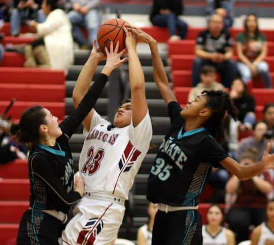 Sophomore Lady 'Cat Harmanie Dominguez (23) led all scorers with 18 points in Deming's 47-39 loss to the Onate High Knights.