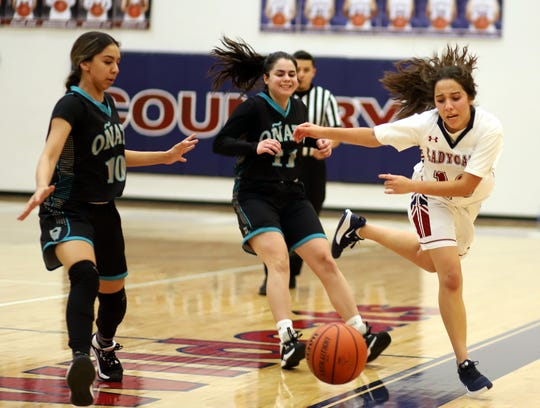 Senior Lady 'Cat Nicole Lopez chased this basketball out-of-bounds during Friday's 47-39 loss to the Onate High Knights.