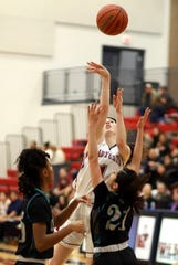 Junior Lady 'Cats Sierra Manos dropped 9 points in Deming's 47-39 loss to the Onate High Knights.
