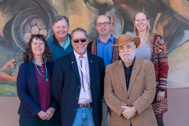 New Mexico State University Department of Geography faculty members include (front from left): Department Head Carol Campbell, Christopher Brown, Michael DeMers, (back from right) Michaela Buenemann, Eric Magrane and Daniel Dugas.