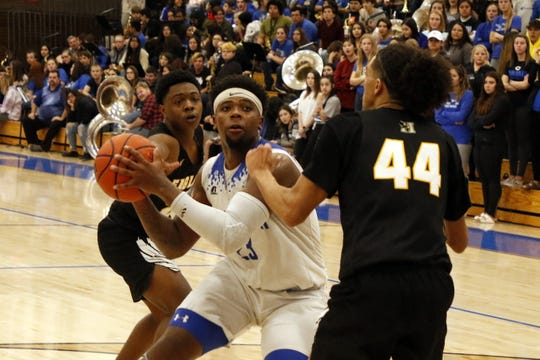 Carlsbad's Shamar Smith posts up for a shot against Hobbs in their District 4-5A game on Feb. 7, 2020. Smith finished with 22 points to lead Carlsbad. Hobbs won, 82-66.