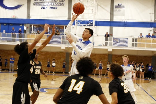 Carlsbad's Damien Perez takes a jump shot against Hobbs in the first half of their District 4-5A game on Feb. 7, 2020. Perez finished with two points. Hobbs won, 82-66.