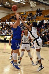 Carlsbad's Kaliyah Montoya is fouled by Hobbs' Wisdom Anthony and goes to the line for and-1 in the third quarter. Montoya missed the free throw and Hobbs defeated Carlsbad, 43-39.