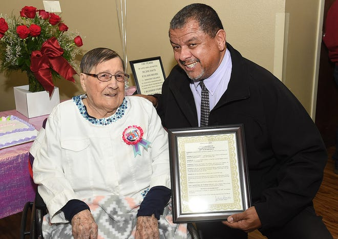 Opelousas Mayor Julius Alsandor presents Octavia Guillory with a proclamation and a key to the city in recognition of her 100th birthday celebrated on Jan. 29 at Heritage Manor Nursing Home.