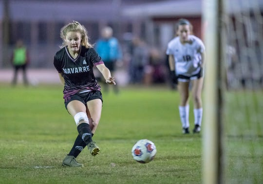 Autumn Slaybaugh (15) boots a penalty kick past the Eagle goalie to tie up the score at 2-2 during the Niceville vs Navarre girls District championship soccer game at Navarre High School on Friday, Feb. 7, 2020.
