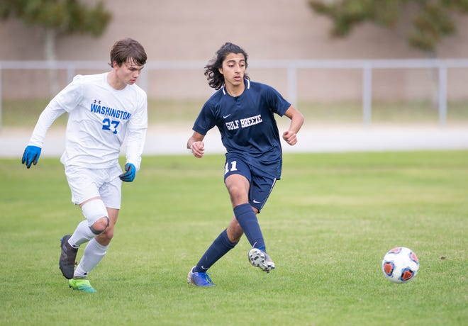 Hanie Kousa (11) passes the ball during the Booker T. Washington vs Gulf Breeze boys soccer district championship soccer game at Gulf Breeze High School on Saturday, Feb, 8, 2020.