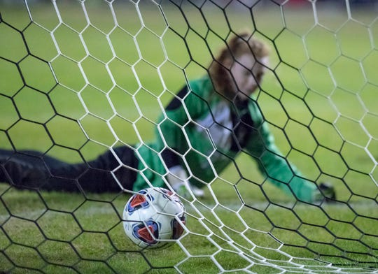 Autumn Slaybaugh (15)'s penalty kick gets past the Eagle goalie to tie up the score at 2-2 during the Niceville vs Navarre girls District championship soccer game at Navarre High School on Friday, Feb. 7, 2020.