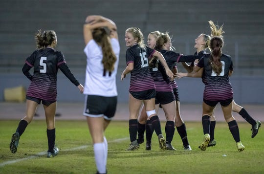The Raiders celebrate taking a 3-2 lead during the Niceville vs Navarre girls District championship soccer game at Navarre High School on Friday, Feb. 7, 2020.