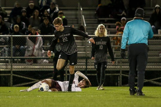 Tate's Matt Johnson (19) reacts after getting knocked to the ground by Navarre's Mateo Shuran (22) in the District 1-6A semifinal game on Friday, February 7, 2020, at Ashton Brosnaham Park. Shuran received a yellow card for unsportsmanlike conduct on this play.