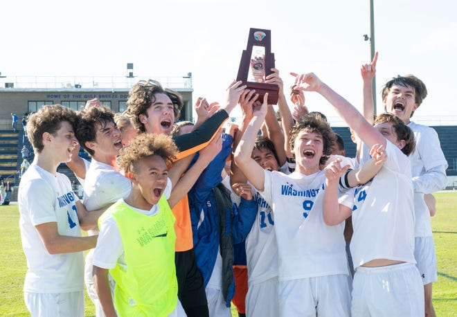 The Wildcats celebrate their 2-1 victory during the Booker T. Washington vs Gulf Breeze boys soccer district championship soccer game at Gulf Breeze High School on Saturday, Feb, 8, 2020.