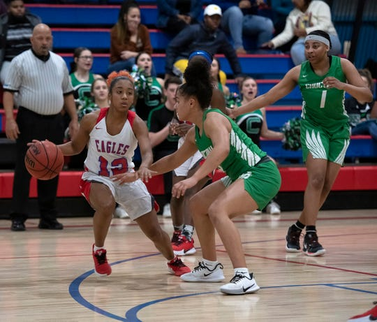 Pine Forest High's Carlysia Santiago (No. 12) takes on the Choctaw High defense during the District 1-5A Championship Game at Pine Forest Friday night.