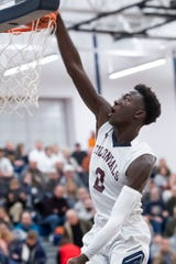 New Oxford's Abdul Janneh dunks in the second quarter of a YAIAA tournament quarterfinal game against Hanover in West York on Friday, Feb. 7, 2020. The Colonials won, 69-41.
