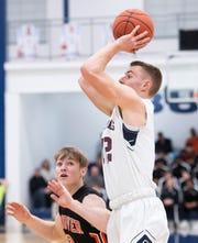 New Oxford's Brayden Long pulls up on a jump shot in the third quarter of a YAIAA tournament quarterfinal game against Hanover in West York on Friday, Feb. 7, 2020. The Colonials won, 69-41.