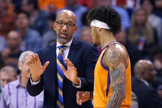 Phoenix Suns coach Monty Williams, left, talks with forward Kelly Oubre Jr. during the second half of the team's NBA basketball game against the Houston Rockets on Friday, Feb. 7, 2020, in Phoenix. The Suns won 127-91. (AP Photo/Ross D. Franklin)