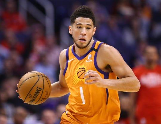 Phoenix Suns guard Devin Booker (1) against the Houston Rockets in the first half on Feb. 7, 2020 in Phoenix, Ariz.