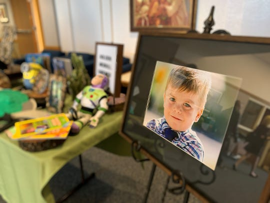 A photo of 6-year-old Holden Gardner, who died Feb. 3 after being hit by a semi-truck, stood at the entrance to Mesa AZ Red Mountain LDS Institute during his funeral service on Feb. 8, 2020.
