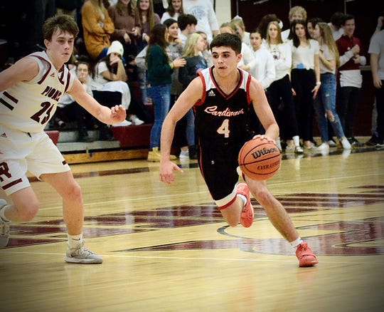 Cardinal Mooney's Nolan Julio dribbles past a defender during a Catholic League boys basketball game on Friday, Feb. 7, 2020, at Riverview Gabriel Richard.