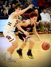 Cardinal Mooney's Jacob Marshell dribbles during a Catholic League boys basketball game on Friday, Feb. 7, 2020, at Riverview Gabriel Richard.