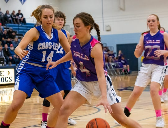 Cros-Lex's Mareena Franzel (14) defends against Yale's Anna Gerardy during the Coaches vs. Cancer game Friday, Feb. 7, 2020, at Yale High School.