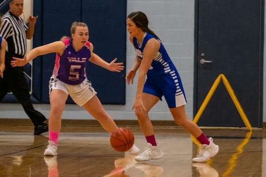 Yale's Kristine Silverthorn (5) defends against Cros-Lex's Kari Baker during the Coaches vs. Cancer game Friday, Feb. 7, 2020, at Yale High School.