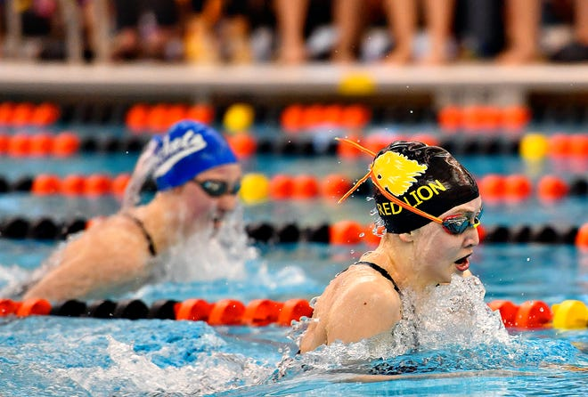 Red Lion's Arabella Butera, front, and Spring Grove's Megan Heist compete in the 100 Yard Breaststroke event during girls' YAIAA Swimming and Diving Championships at Central York High School in Springettsbury Township, Saturday, Feb. 8, 2020. Butera would win the event at 1:04.24. Dawn J. Sagert photo
