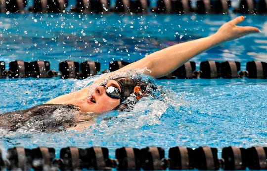 Central York's Camryn Leydig wins the 100 Yard Backstroke at 55.99 during girls' YAIAA Swimming and Diving Championships at Central York High School in Springettsbury Township, Saturday, Feb. 8, 2020. Dawn J. Sagert photo