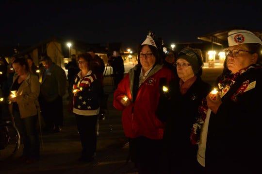 Attendees gather for a vigil for slain U.S. Navy veteran, Jana McElhaney, 54, on Feb. 6, 2020.