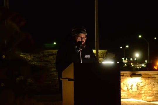 Shayne Powell, 36, speaks at a vigil on Feb. 6, 2020, about Jana McElhaney, 54, who died of head injuries following a reported attack.
