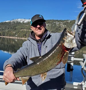 James Netzel successfully battled this gorgeous mackinaw trout while fishing at Donner Lake in early February.
