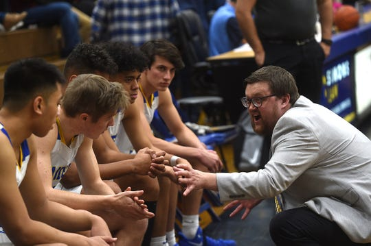 Reed head coach Keegan Bosier talks with his players while taking on Reno during their basketball game in Sparks on Feb. 7, 2020.