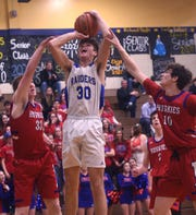 Reed's Kellen George gets fouled while taking on Reno during their basketball game in Sparks on Feb. 7, 2020.