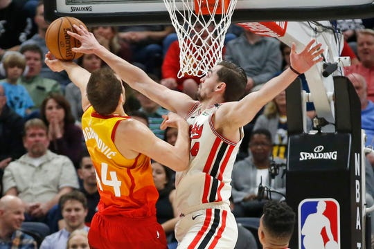 Portland Trail Blazers forward Mario Hezonja, right, blocks the shot of Utah Jazz forward Bojan Bogdanovic during the first half of an NBA basketball game Friday, Feb. 7, 2020, in Salt Lake City.