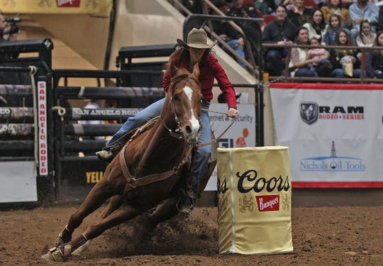 Stephenville's Halyn Lide competes in the barrel racing event during the San Angelo Stock Show and Rodeo on Friday, Feb. 7, 2020.