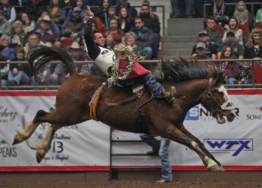 Tim O' Connell competes in the bareback event during the San Angelo Stock Show and Rodeo on Friday, Feb. 7, 2020.