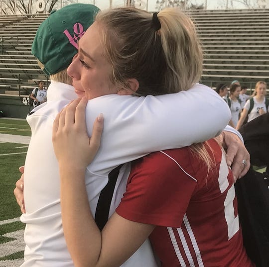 Parkway coach Shelley McMillian hugs senior Lauren Sepeda following the Lady Panthers' final game of 2020.