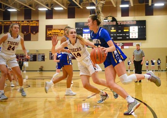 Emma Ronsiek of O'Gorman dribbles around Brecli Honner of Harrisburg during their game on Thursday, Feb. 6, at Harrisburg High School.