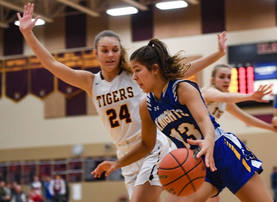 Isabelle Moore of O'Gorman dribbles past Aby Phipps of Harrisburg during their game on Thursday, Feb. 6, at Harrisburg High School.