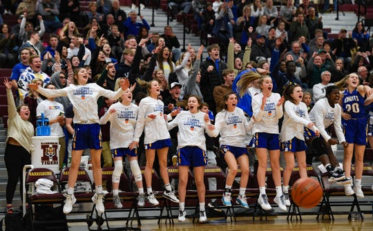 O'Gorman fans and team members jump and yell as they take the lead in the final moments of the game on Thursday, Feb. 6, at Harrisburg High School.