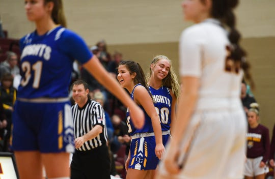 Isabelle Moore and Hannah Ronsiek of O'Gorman smile as the clock counts down and the team wins on Thursday, Feb. 6, at Harrisburg High School.