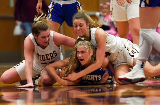 Hannah Ronsiek of O'Gorman and Aby Phipps and Faith Van Holland of Harrisburg fight for a loose ball during their game on Thursday, Feb. 6, at Harrisburg High School.