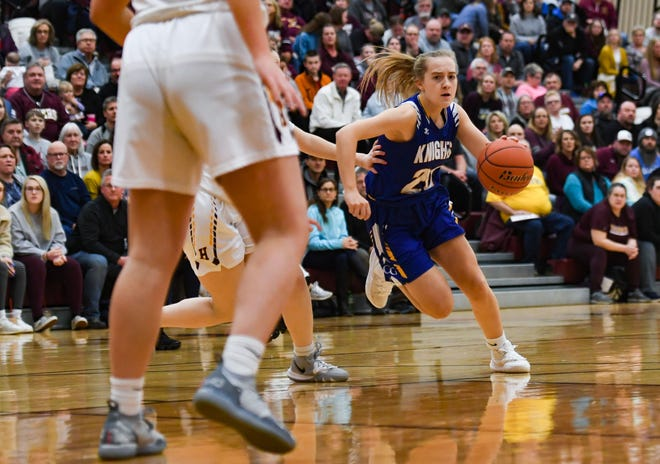 Allison Crouch of O'Gorman dribbles past Harrisburg players during their game on Thursday, Feb. 6, at Harrisburg High School.