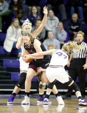 Missouri State's Abby Hipp protects the ball against Northern Iowa's  Bre Gunnels (11) and Megan Maahs during action at the McLeod Center in Cedar Falls, Iowa, Friday Feb. 7, 2020.