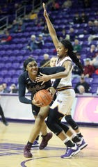 Missouri State's Jasmine Franklin looks for a path to the basket around Northern Iowa's Bre Gunnels during action at the McLeod Center in Cedar Falls, Iowa, Friday Feb. 7, 2020.